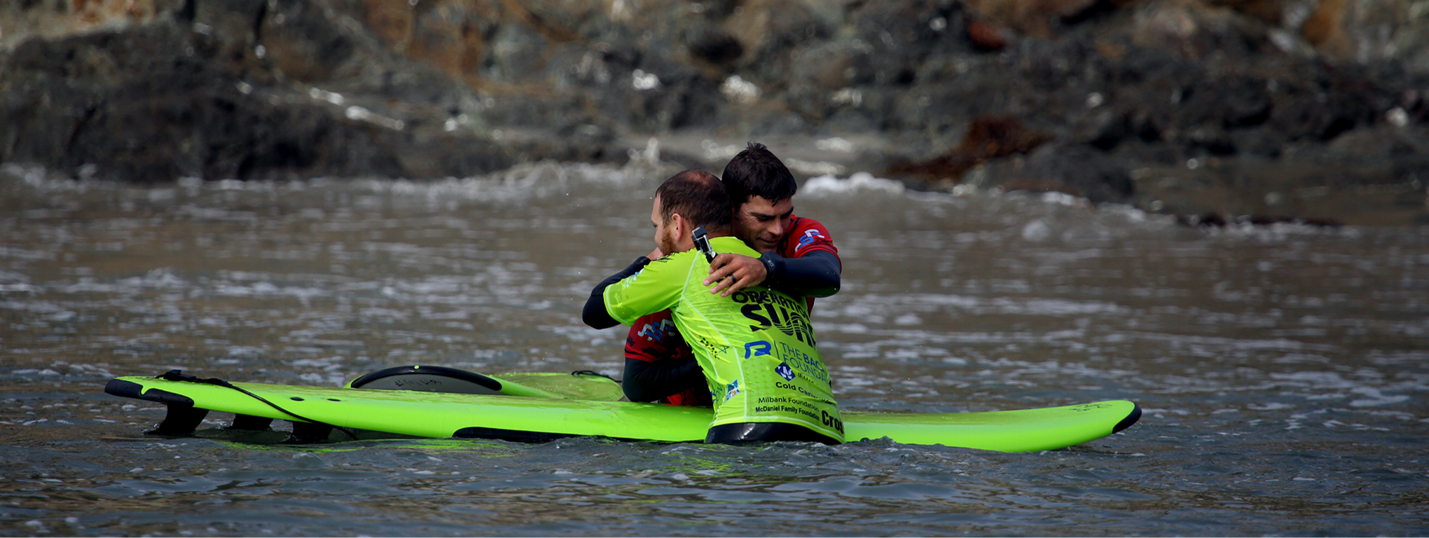 A participant and instructor hug