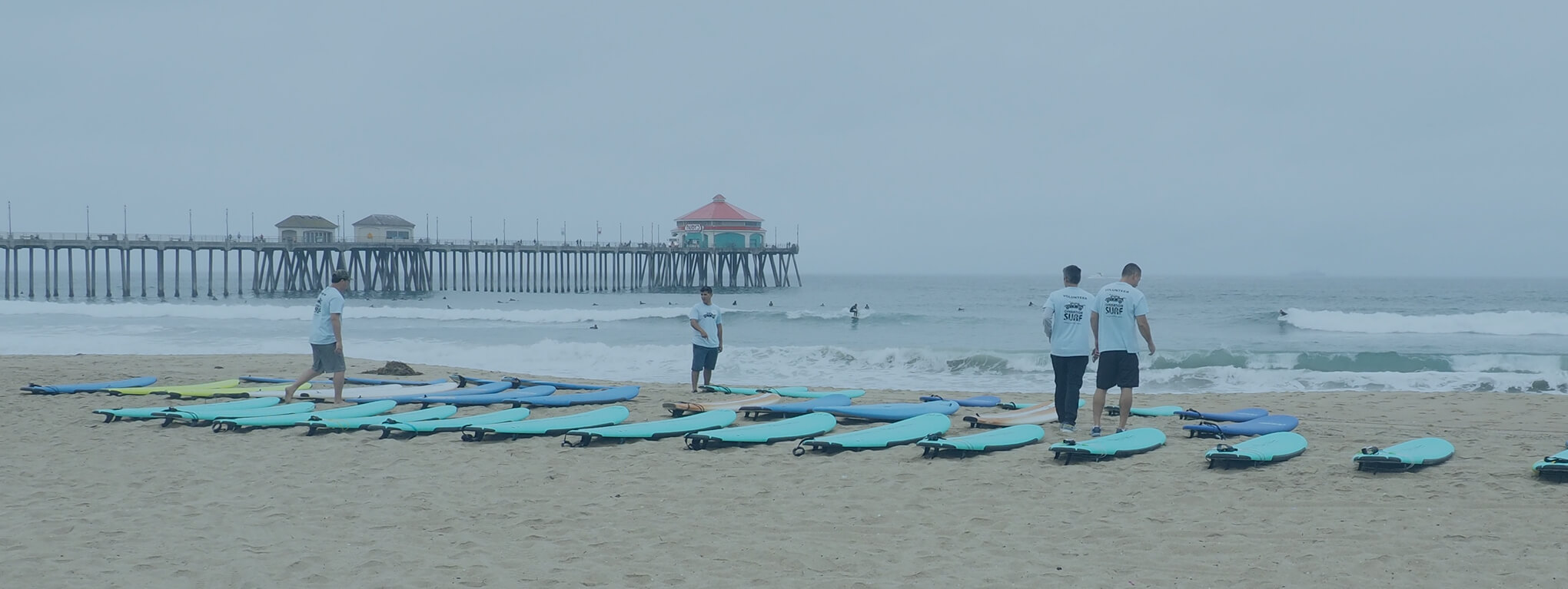 Volunteers line up surfboards at Huntington Beach