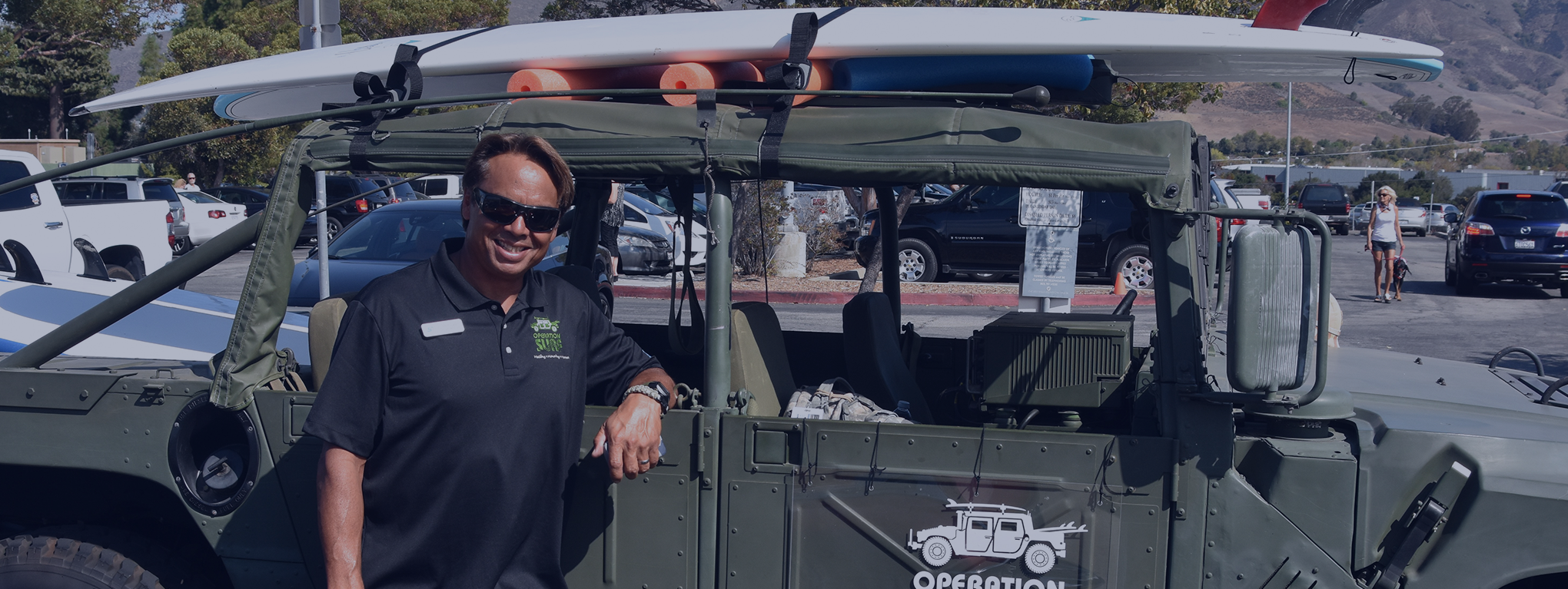 Instructor Van Curaza poses with jeep
