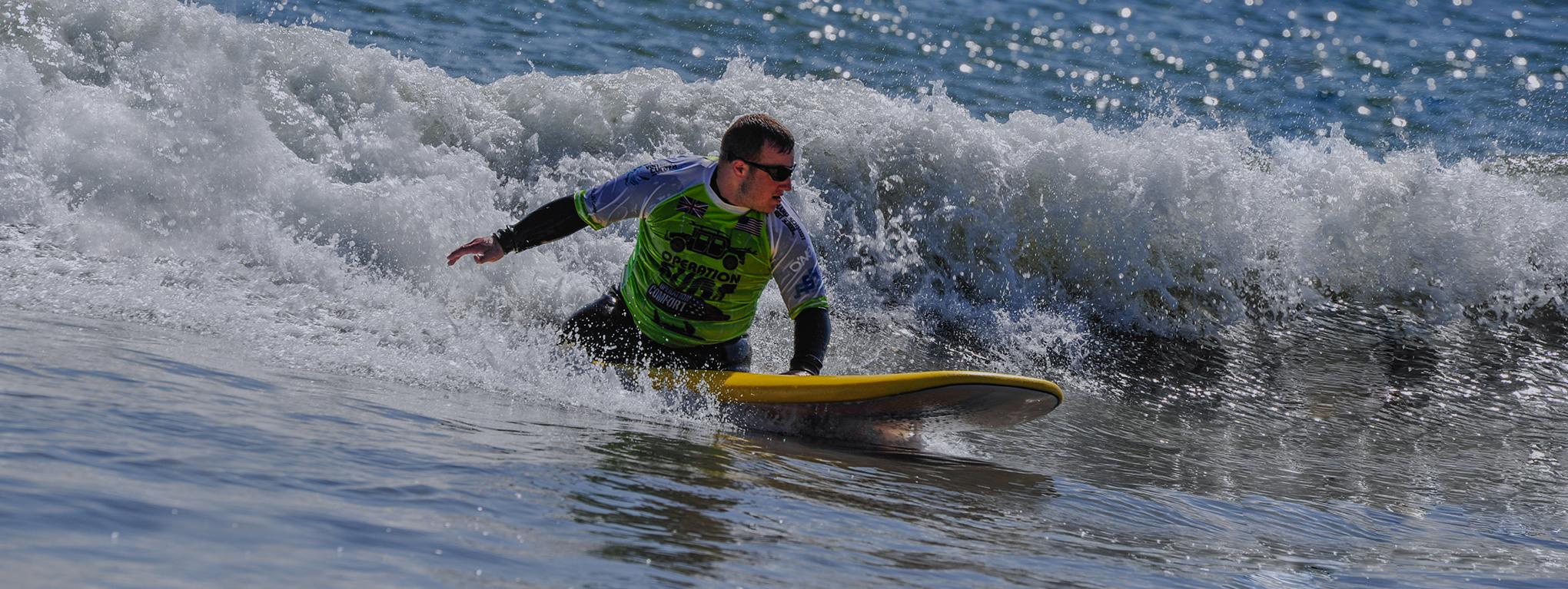 A participant rides a wave