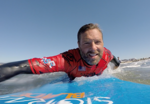 Instructor Noah Greenberg rides a wave