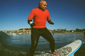 Juan A., Army, rides a wave